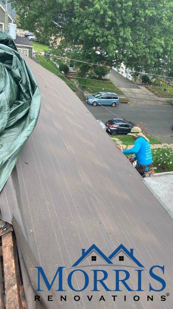 Professional technician performing roof repair